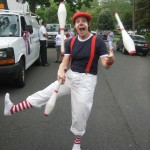 Red, white, and blue parade juggler