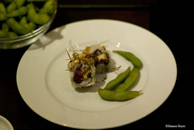 Roll and edamame composition