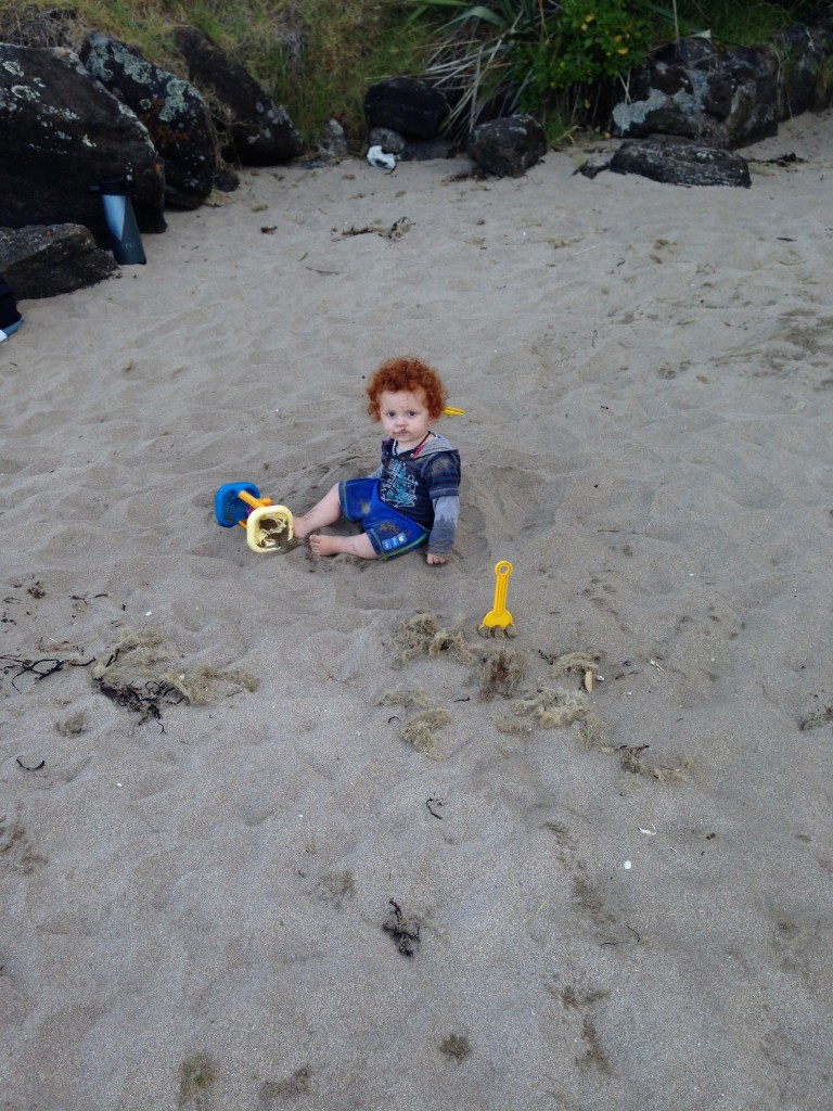 Kid in sand, Cheltenham Beach, Devenport, NZ